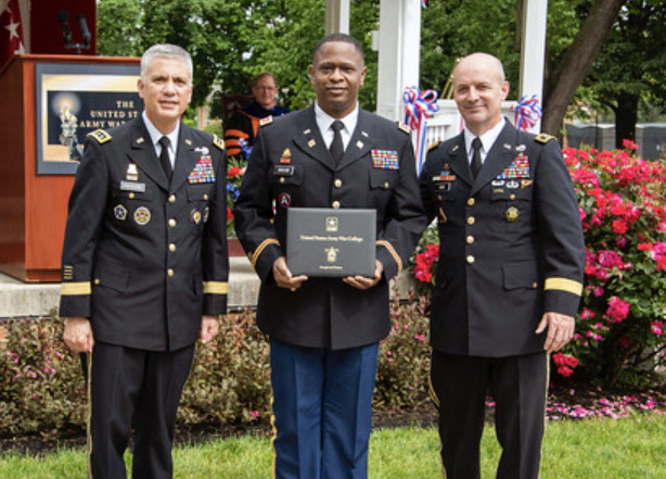 Pictured above (from left): GEN Paul Nakasone, guest speaker, Commander of USCYBERCOMMAND and Director of the National Security Agency *** Lieutenant Colonel G. Torrie Jackson, Jr. *** Major General John Kem, Commandant, United States Army War College. 				              (Photo Submitted)